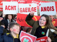 Irish language act campaigners, including pupils from Irish-medium schools across Northern Ireland, take part in a protest at Stormont (Brian Lawless/PA)