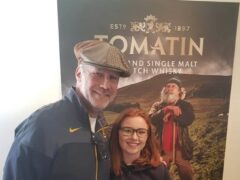 Actor Will Ferrell, with a member of staff at the Tomatin distillery (Tomatin distillery/PA)
