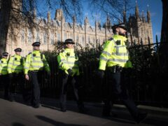 Metropolitan Police officers stand outside the Houses of Parliament (Stefan Rousseau/PA)