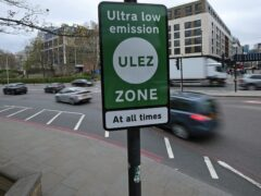 An Ultra Low Emission Zone information sign at Tower Hill in central London (PA)
