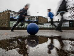 School children play during a break at a primary school in Yorkshire (Danny Lawson/PA)