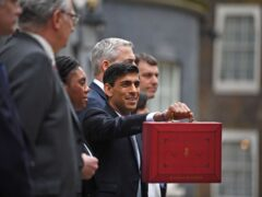 Chancellor's traditionally pose with their Treasury ministerial team before their Budget speech (Victoria Jones/PA)