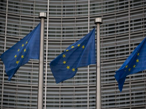 A view of EU flags outside The Berlaymont building, the Headquarters of the European Commission in Brussels.