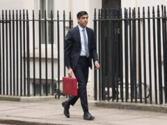 Chancellor of the Exchequer, Rishi Sunak outside 11 Downing Street, London, before heading to the House of Commons to deliver his Budget in March (Stefan Rousseau/PA)