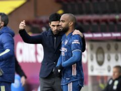 Arsenal manager Mikel Arteta, left, has spoken on Alexandre Lacazette's contract issue (Peter Powell/PA)