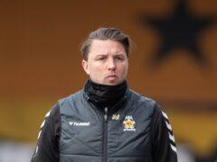 Mark Bonner's Cambridge face Sheffield Wednesday on Tuesday (Joe Giddens/PA)