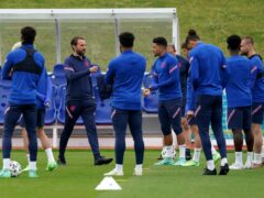 Five of Gareth Southgate's (second left) England squad are reportedly refusing to be vaccinated against coronavirus (Martin Rickett/PA)