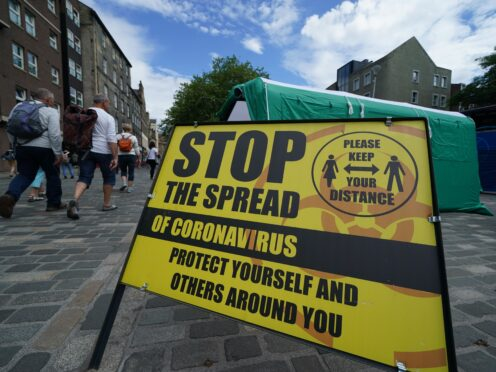 A Covid-19 information sign at the Grassmarket in Edinburgh (Andrew Milligan/PA)