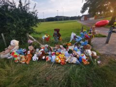 Tributes left near Pandy Park in Sarn, Bridgend, close to where the body of Logan Mwangi was discovered (PA)