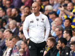 AFC Wimbledon manager Mark Robinson saw his side claim victory at Lincoln (Tess Derry/PA)