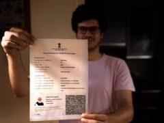 A boy displays his Covishield vaccination certificate in New Delhi, India (Manish Swarup/AP)