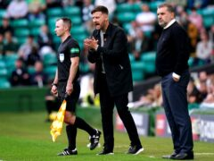 Dundee United manager Tam Courts, centre, wants his side to back up their Celtic Park point (Jane Barlow/PA)