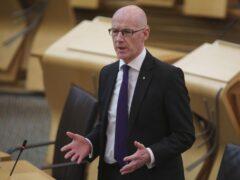 John Swinney spoke to MSPs on Tuesday (Fraser Bremner/PA)