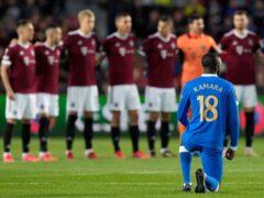 Glen Kamara kneels before the start of the Europa League match (Petr David Josek/AP)