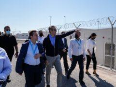 Greece's Migration Minister Notis Mitarachis and Prime Minister Kyriakos Mitsotakis new facility for migrants and refugees on Samos (Thanassis Stavrakis/AP)