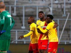 Arnaud Kalimuendo, right, celebrates after scoring Lens' second goal against Reims (Michel Spingler/AP)