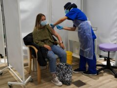 A person receives a Covid-19 Pfizer jab at a pop-up vaccination centre at Westfield Stratford City shopping centre in east London (Kirsty O'Connor/PA)