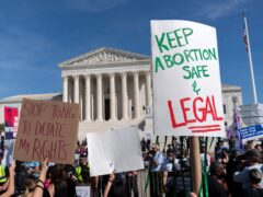 Demonstrators march outside the US Supreme Court during the Women's March in Washington (Jose Luis Magana/AP)