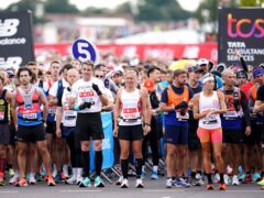 Runners including James Cracknell and Sophie Raworth prepare to start the event (John Walton/PA)