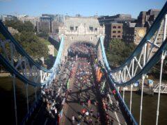 Runners cross over Tower Bridge during the Virgin Money London Marathon (Steven Paston/PA)