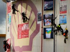 Dutch police break up a demonstration by Greenpeace activists (Peter Dejong/AP)