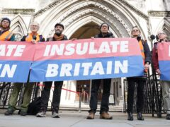 Members of Insulate Britain outside the Royal Courts of Justice in London (Ian West/PA)