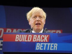 Prime Minister Boris Johnson delivers his keynote speech at the Conservative party conference in Manchester (PA)