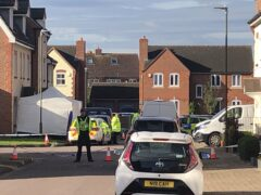 Policed activity in Snowdonia Road, Walton Cardiff, near Tewkesbury, after one man was stabbed to death and two other people were injured (Rod Minchin/PA)