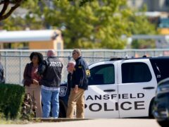 Law enforcement officers gather at Timberview High School (LM Otero/AP)