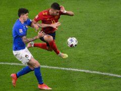 Ferran Torres, right, has fractured a bone in his right foot (Marco Bertorello/AP)