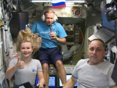 Actress Yulia Peresild, left, film director Klim Shipenko, centre, and cosmonaut Anton Shkaplerov son the International Space Station (Roscosmos Space Agency/AP)