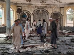 People view the damage inside of a mosque following a bombing in Kunduz (Abdullah Sahil/AP)