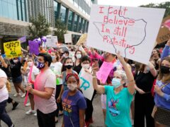 People participate in the Houston Women's March against the Texas abortion ban earlier this month (Melissa Phillip/Houston Chronicle/AP)