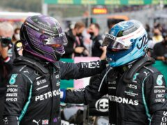 Lewis Hamilton (left) starts 11th on the grid due to a penalty as Valtteri Bottas starts on pole (Umit Bektas/AP)