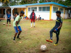 Young footballers pass the ball around during a coaching session at a training hub in Mauritius, where youngsters are given free sports training and coaching to help them pursue a career in professional sport (Ben Birchall/PA)