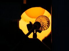A glass-worker heats a glass artistic creation in a methane powered oven in Murano island, Venice (Antonio Calanni/AP)