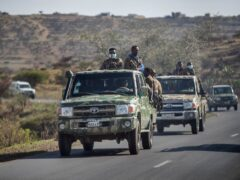 Ethiopian government soldiers ride in the back of trucks on a road near Agula, north of Mekele, in the Tigray region of northern Ethiopia (Ben Curtis/AP)