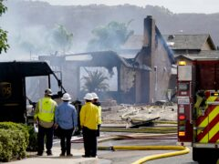Fire and safety crews work at the scene of a plane crash in Santee, California (Gregory Bull/AP)