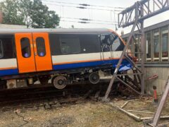 Two people were injured when a train carrying around 50 passengers crashed through buffers at Enfield Town station in north London (London Fire Brigade/PA)
