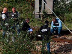 Police at the scene (Bob Edme/PA))