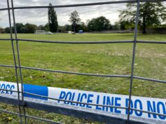 Police tape at the scene on a playing field in Craneford Way, Twickenham, where an 18-year-old was stabbed on Tuesday (Sophie Wingate/PA)