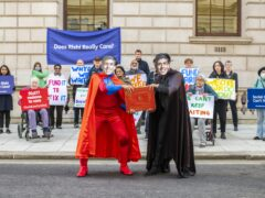 A protest by Age UK and other members of the Care Support Alliance outside the Treasury in London (Jamie Lau/Age UK/PA)