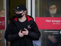 People wearing face masks to help curb the spread of coronavirus leave a subway in Moscow (Alexander Zemlianichenko/AP)