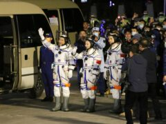 From left, Chinese astronauts Zhai Zhigang, Wang Yaping, and Ye Guangfu, wave before leaving for the Shenzhou-13 crewed space mission at the Jiuquan Satellite Launch Centre in northwest China (Chinatopix/AP)