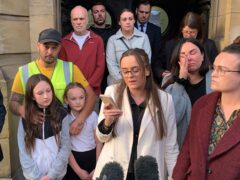 Tia Skelton (centre), the sister of Lewis Skelton, is surrounded by members of their family and solicitor Neil Hudgell (left) as she reads a statement to the media outside Hull Coroners Court (Dave Higgens/PA)