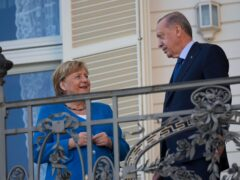 Turkey's President Recep Tayyip Erdogan, right, talks to German Chancellor Angela Merkel during their meeting at Huber Villa presidential palace, in Istanbul, Turkey, Saturday, October 16 (Francisco Seco/AP)