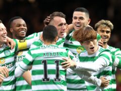 Celtic's David Turnbull (centre) is mobbed by team-mates after scoring against his former club (Steve Welsh/PA)