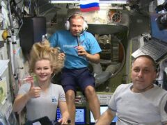 Actress Yulia Peresild, left, film director Klim Shipenko, centre, and cosmonaut Anton Shkaplerov aboard the ISS earlier this month (Roscosmos Space Agency/AP)