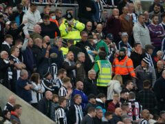 Medical personal were called to assist a fan in the stands during the Premier League match between Newcastle and Tottenham (Owen Humphreys/PA)