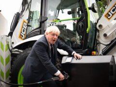 Prime Minister Boris Johnson with a hydrogen-powered JCB Loadall telescopic handler (Stefan Rousseau/PA)